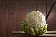 Organic cauliflower on wooden table - ONF000118