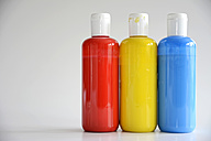 Red, Yellow, Blue bottles on gray background - ONF000129