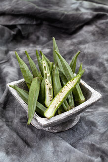 Okra beans on textile, close up - CSF018590