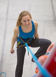 Germany, Bavaria, Munich, Young woman taking break, smiling - HSIYF000234