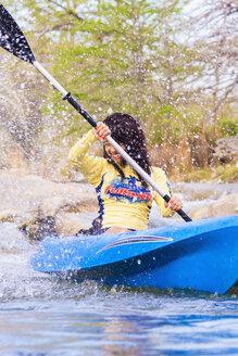 USA, Texas, Young woman kayaking on Frio River, smiling - ABAF000808