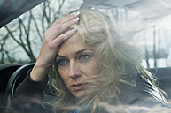 Germany, Brandenburg, Thoughtful  woman in car - BFRF000213