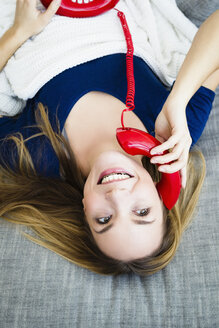 Germany, Bavaria, Munich, Young woman talking on telephone, smiling - SPOF000286