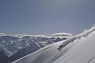Austria, Man skiing on snowcapped mountains - FF001335