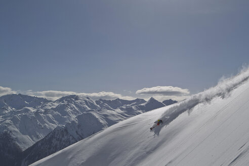 Austria, Man skiing on snowcapped mountains - FF001335