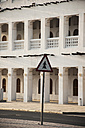 Qatar, Doha, Street sign on road with building in background - FB000029