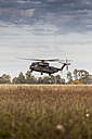 Germany, Laupheim, German CH-53 helicopter flying in air - HA000021