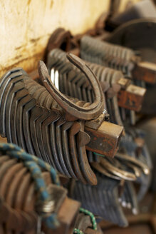Germany, Horseshoe stacked in workers garage - TK000116