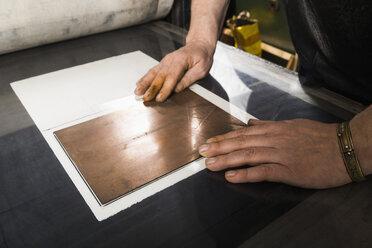Germany, Bavaria, Mature man working in print shop - TC003417