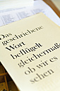 Germany, Bavaria, Page printed with lead typesetting in print shop, close up - TC003440