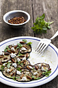 Plate of feta salad with nuts in bowl, close up - EVG000092