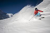 Austria, Salzburg, Young man skiing in mountain of Altenmarkt Zauchensee - HHF004569