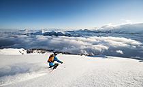Austria, Salzburg, Mid adult man skiing in mountain of Altenmarkt Zauchensee - HHF004595
