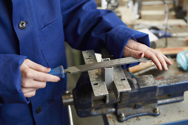 Germany, Kaufbeuren, Woman working in manufacturing industry - DSC000070