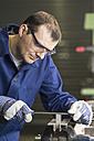 Germany, Kaufbeuren, Man working in manufacturing industry - CA000004