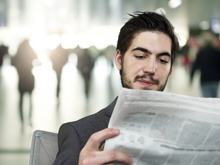 Young businessman reading newspaper - STKF000273