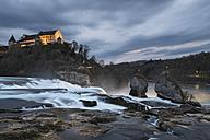Switzerland, Schaffhausen, View of waterfall at dusk - EL000005