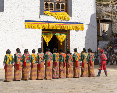 Bhutan, People performing folk dance in Paro festival - HL000168