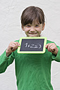 Girl holding blackboard with numbers - LVF000063