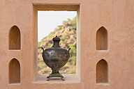 India, Rajasthan, Tin bowl on window sill at Neemrana fort Palace Hotel - HL000191