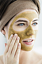 Germany, Bavaria, Munich, Young woman with clay mask, close up - SPOF000418