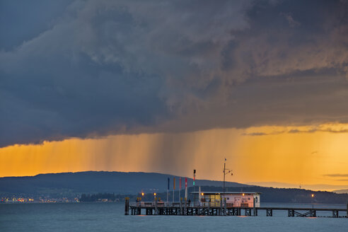 Germany, Ferry jetty and rain clouds at Lake Constance - SH000676