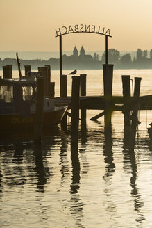 Germany, View of Lake Constance and seagull perching on mooring post - SH000694
