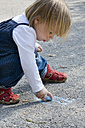 Germany, Little girl using chalk - LVF000075
