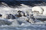 Germany, Hesse, Ice on boulder in river - SRF000096