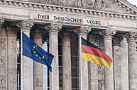 Germany, Berlin, Flags in front of Reichstag Building - CB000071