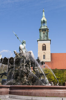 Germany, Berlin, View of Neptunbrunnen fountain with Saint Marys Church in background - CB000068