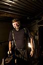 Portrait of blacksmith in his workshop - CNF000055