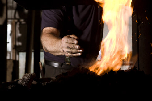 Blacksmith at work at the fireplace - CNF000057