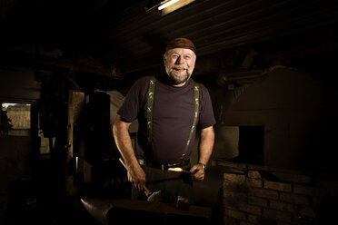 Portrait of happy blacksmith in his workshop - CNF000066