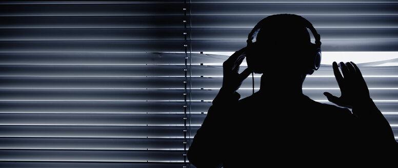 Germany, Bavaria, Man with head phone in recording studio - DSC000079