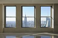 USA, New York State, New York City, View to Empire State Building through window - RUE001068