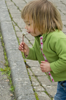 Germany, Baden Wuerttemberg, Tuebingen, Girl blowing dandelion flower, close up - LVF000077