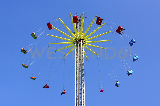 Germany, Chairoplane against blue sky - HOH000166
