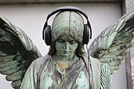 Germany, Cologne, Angel statue with headphones in cemetery - JAT000059