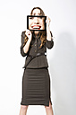 Businesswoman taking picture with digital tablet, smiling - MAEF006790