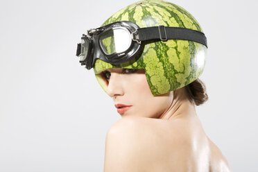 Young woman wearing watermelon helmet, close up - MAEF006819