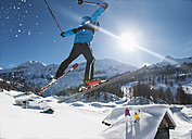 Austria, Salzburg, Young man ski jumping in mountains - HH004633