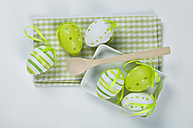 Easter eggs with napkin, wooden spoon on white background - ASF004977