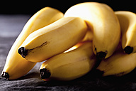 Bunch of bananas on textile, close up - CSF019391