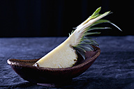 Slice of pineapple in basket, close up - CSF019309