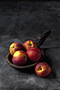 Peaches on wooden spoon, close up - CSF019356