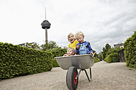 Germany, Cologne, Boys and baby girl in wheelbarrow - RHYF000451