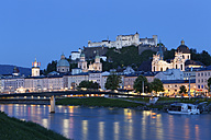Austria, Salzburg, View of Collegiate Church and Hohensalzburg Castle at River Salzach - SIE003922
