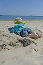 Germany, Mecklenburg Western Pomerania, Boy relaxing on sand at baltic sea - MJF000171