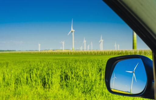 Germany, Saxony, Wind turbines in oilseed rape field - MJF000182